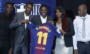 Ousmane Dembélé poses for the media with his family during his Barcelona unveiling at the Camp Nou in August 2017.