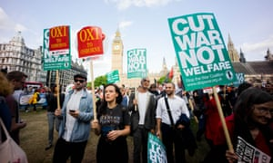 Anti austerity protesters gather outside parliament square as the Chancellor George Osborne announced his budget. Photograph: Geovien So/Barcroft Media