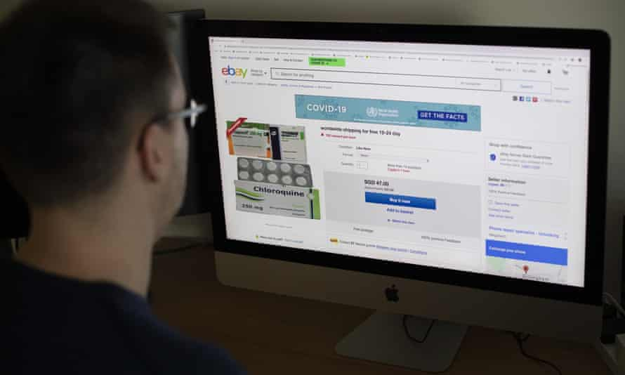 Man looks at ad for hydroxychloroquine