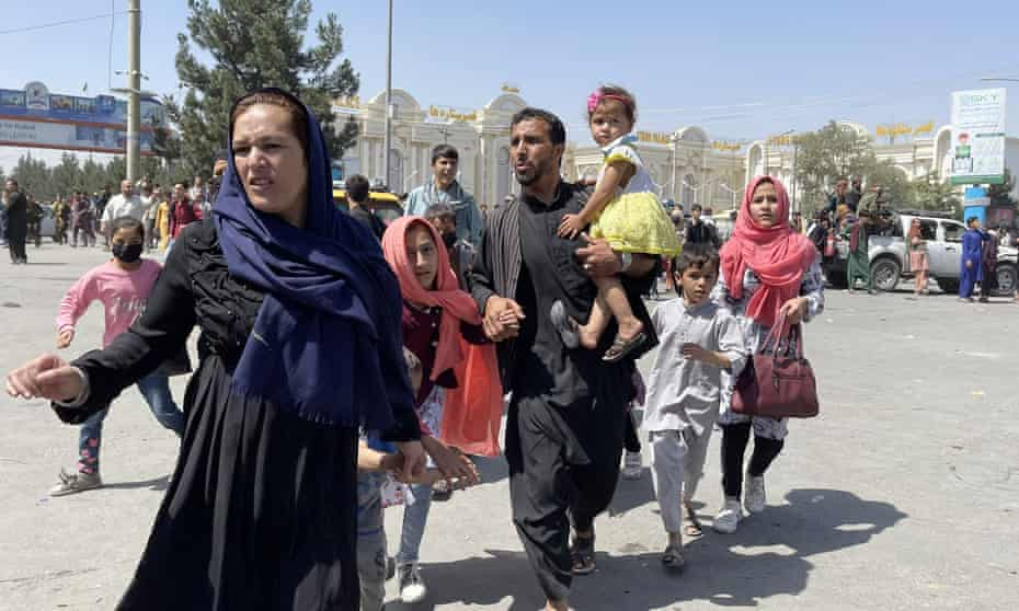 Afghans rush to the airport in Kabul, Afghanistan, 16 August 2021.
