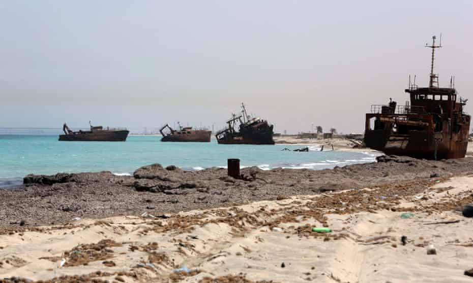 Shipwrecks are seen on the coast of the north-western Libyan port city of Zuwara – one of the country's main people-smuggling hubs.
