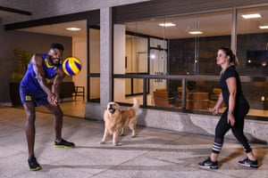 Isac Viana, an international national volleyball player for Brazil, trains with his wife Luíla Melo and their dog Thor in Belo Horizonte.