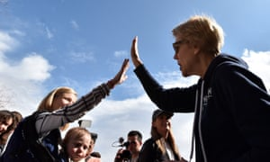 Elizabeth Warren greets supporters during a visit to a caucus site at Coronado high school in Henderson.