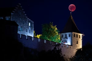 Here the moon appears as a giant weathervane on top of the Castle Luafen's turret, in Switzerland.