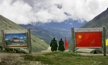 Chinese army officers stand on China's side of the international border at Nathu La Pass, in northeastern Indian state of Sikkim.