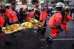 Paramedics carry an injured man