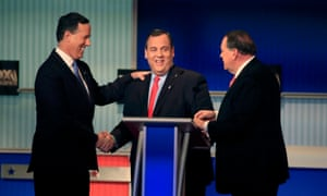 Republican U.S. presidential candidates Rick Santorum, Christie and Huckabee shake hands at the conclusion of a forum for lower polling candidates held by Fox Business Network before the U.S. Republican presidential candidates debate in Milwaukee<br>Republican U.S. presidential candidates (L-R) former U.S. Senator Rick Santorum, New Jersey Governor Chris Christie and former Arkansas Governor Mike Huckabee shake hands at the conclusion of a forum for lower polling candidates held by Fox Business Network before the U.S. Republican presidential candidates debate in Milwaukee, Wisconsin, November 10, 2015. REUTERS/Darren Hauck