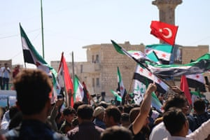Thousands of people waving Free Syrian Army flags and wearing facepaint have taken to the streets of towms around Idlib in recent weeks in anti-regime and anti Islamist protests