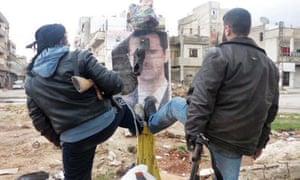 Syrian rebels step on a portrait of Bashar al-Assad