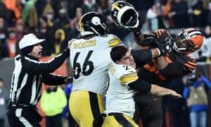 Myles Garrett (95) hits Pittsburgh Steelers quarterback Mason Rudolph (2) with his own helmet
