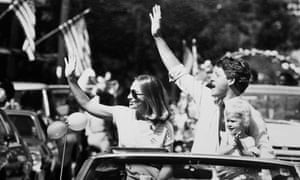 Governor Bill Clinton with his wife Hillary Rodham and their daughter Chelsea, greeting the crowd on the campaign trail in Arkansas in 1988.