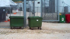 Rubbish bins line the outside of the detention centre near the living quarters of some asylum seekers.