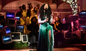 Musical guest SZA performs on Saturday Night Live.