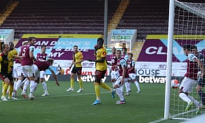 Troy Deeney of Watford header cleared off line by Dwight McNeil of Burnley.