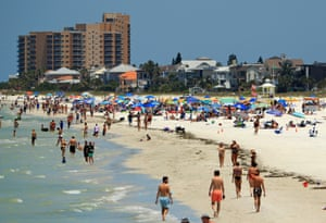 People visit Clearwater Beach after Governor Ron DeSantis opened the beaches on 4 May in Clearwater, Florida.