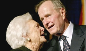 Former U.S. President George Bush speaks with his wife Barbara in Miami