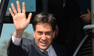 Britain's Opposition Labour leader Ed Miliband waves as he boards his campaign election bus after delivering a speech at Pensby High School in Pensby, north-west England.