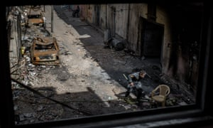 A member of the Iraqi federal police runs through a sniper alley in west Mosul.