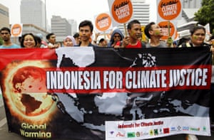 Protesters participate in a climate march in Jakarta on Sunday.