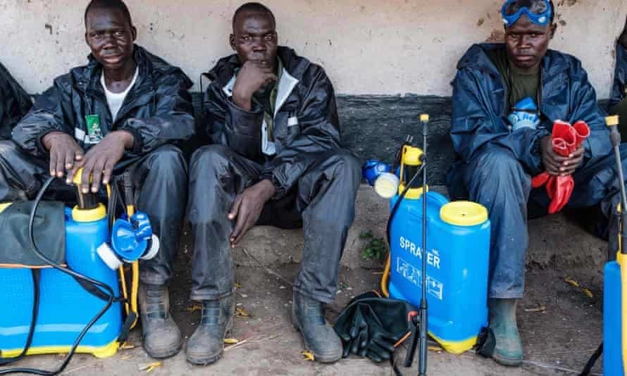 Ugandan soldiers rest after spraying insecticide