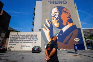Atlanta, Georgia, US: People gather at a large mural of the civil rights leader and Democratic representative from Georgia, John Lewis, along historic Auburn Avenue. Lewis died, aged 80, on 17 July 2020 after being diagnosed with pancreatic cancer last year. He was the youngest leader in the 1963 March on Washington.