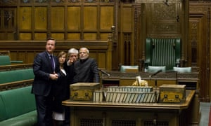 David Cameron (L), Lady D'Souza, and John Bercow, the Commons Speaker, show Modi the House of Commons chamber.