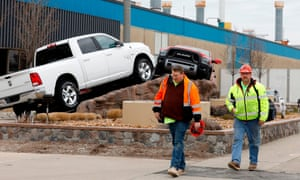 Construction workers leave FCA Chrysler Warren Truck Assembly after the Detroit three automakers have agreed to UAW demands to shut down all North America plants as a precaution against coronavirus.