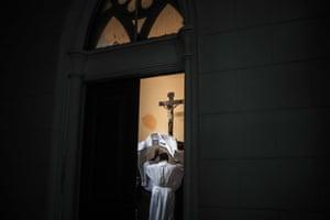 A priest dresses for mass