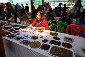 A seller trading rubies and other gemstones at the gems market in Mogok town, north of Mandalay