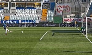 Spal's Andrea Petagna (L) scores a penalty during the Italian Serie A match between Parma and Spal in Parma.