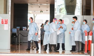 Hotel quarantine workers wearing full PPE at the Grand Hyatt Melbourne hotel.
