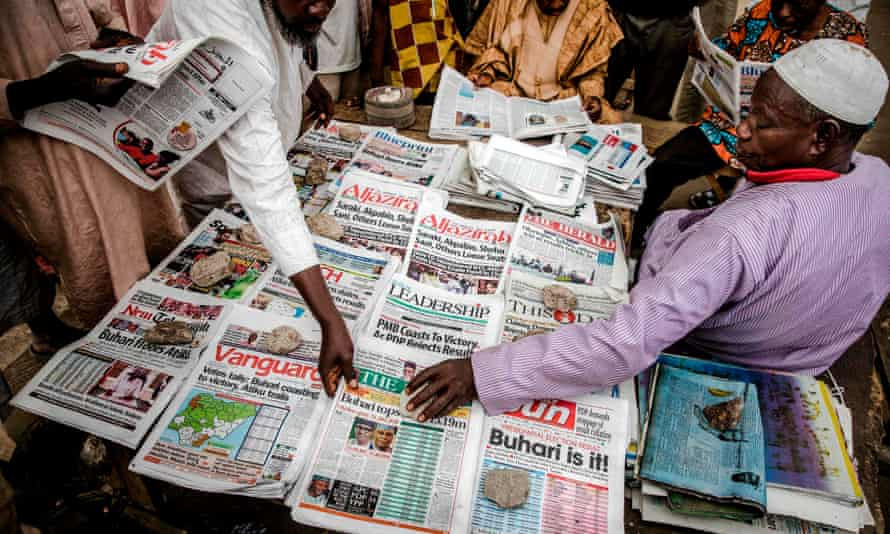 Newspapers on sale in Kano, Nigeria, after Muhammadu Buhari's victory in the presidential election.