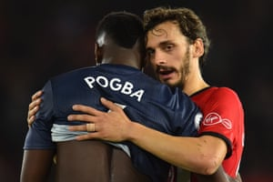 Paul Pogba is embraced by Manolo Gabbiadini at the end of the match.