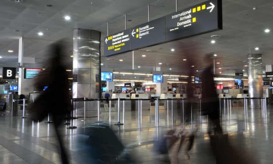 Passengers walk through Melbourne airport