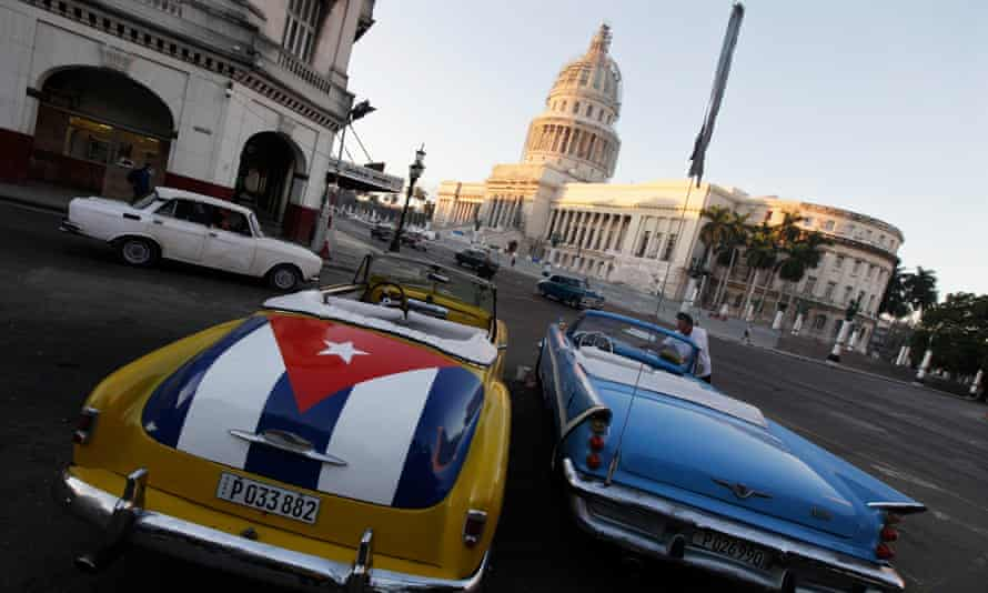A car with a Cuban flag near the Capitol in Havana. The president is widely expected to follow a harder line against Havana.