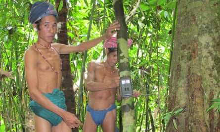 Indigenous people trained as parabiologists set up camera traps in the Chittagong Hills Tract region of Bangladesh.