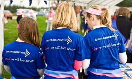 Young volunteers working for Cancer Research UK charity.