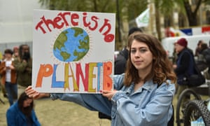 A protester holds a placard saying 'There is no planet B' during a Climate emergency protest in Parliament Square on 1 May.