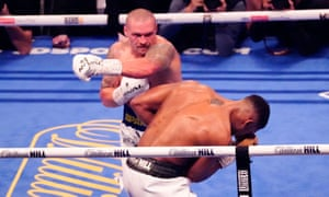 Anthony Joshua is rocked by a left hook from Oleksandr Usyk.