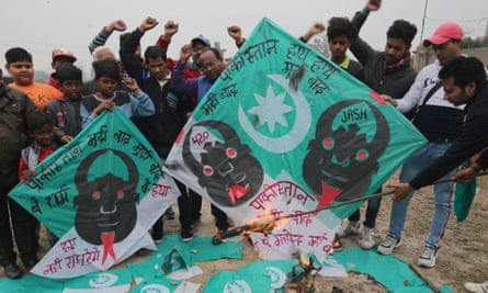 People shout anti-Pakistan slogans as they burn Pakistani flags and kites following the Kashmir bombing.