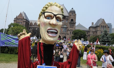A puppet of Kathleen Wynne appears at the Queens Park Jobs, Justice and Climate Rally in Toronto.