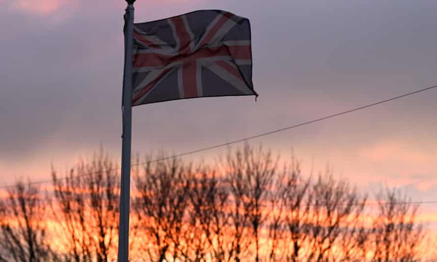 A union flag flutters in the breeze as the sun sets in Hartlepool, north-east England