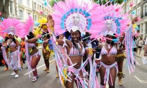 Women dancing at Notting Hill carnival.