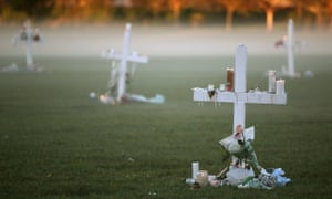 Candles and crosses left after a vigil for victims of the mass shooting at Marjory Stoneman Douglas high school in Parkland, Florida.