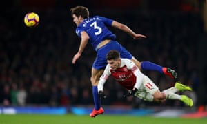 Marcos Alonso of Chelsea battles for possession with Lucas Torreira of Arsenal.