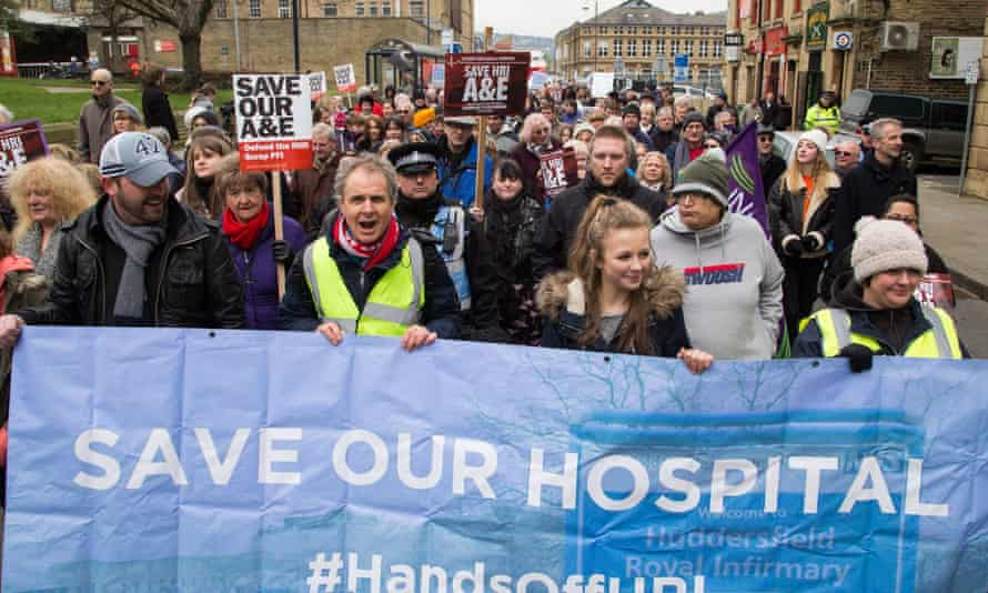 Thousands of protesters marched through Huddersfield in opposition fight to save the town's accident and emergency unit.