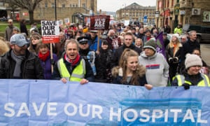 Protesters march to about the planned closure of the A&E department at Huddersfield royal infirmary.