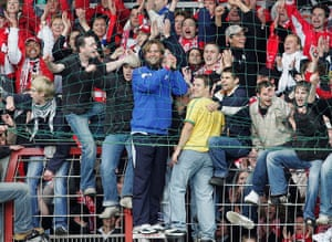 Jürgen Klopp joins the Mainz fans after keeping the club in the Bundesliga in 2005.