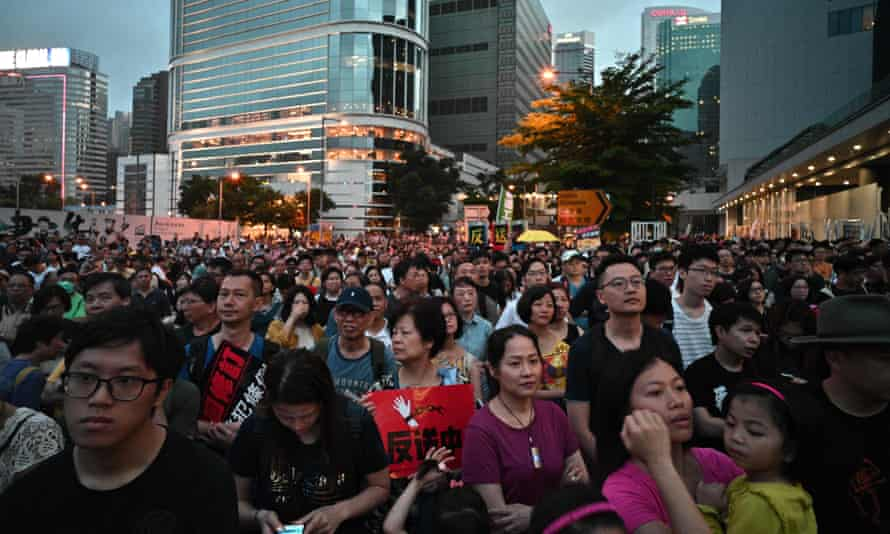 Hong Kong residents attend the protest against a move by the government to allow extraditions to China