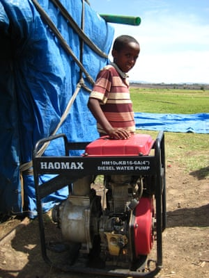 A young boy stands next to a newly installed water pump in the Rift Valley, Ethiopia